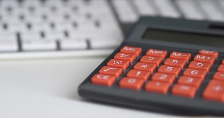 a calculator being used to determine the cost of a Massachusetts business insurance policy