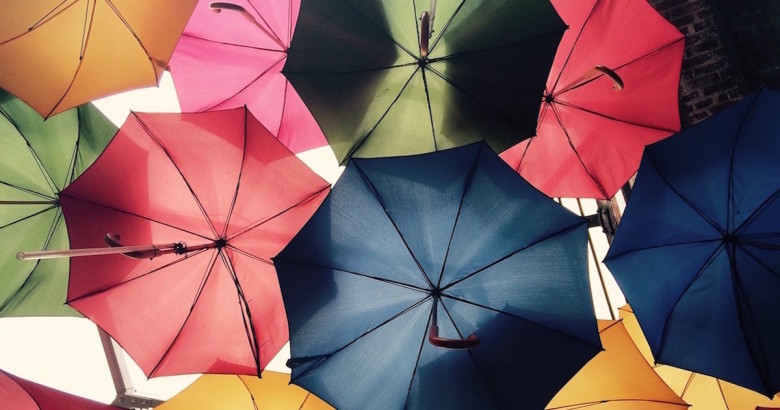 a group of umbrellas being used to represent a Massachusetts umbrella insurance policy