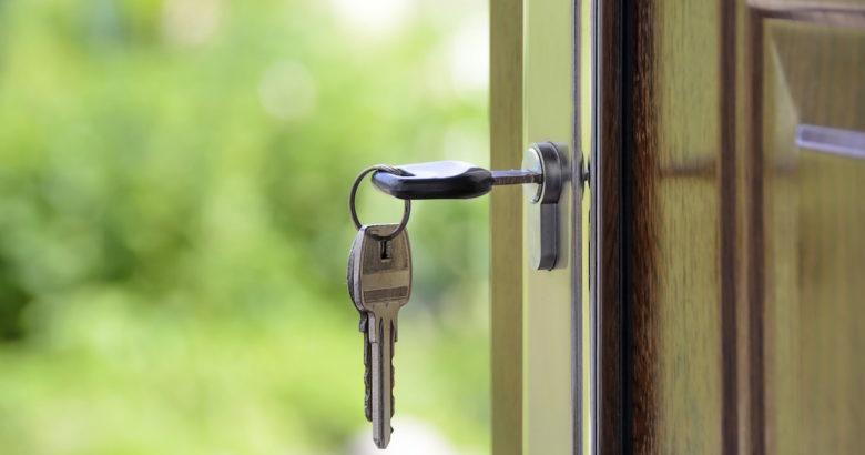 keys in the door of a new home.